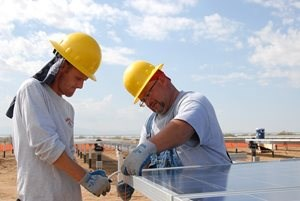 Construction workers setting up solar panels